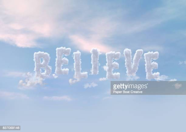 the word believe formed by clouds - typographies stock photos and pictures