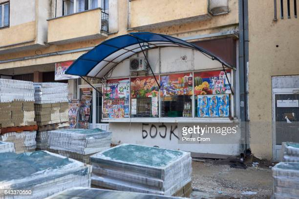 The word boycott is seen tagged on a local grocery near the bridge connecting the Albanian and Serbian parts of Mitrovica as the bridge is under...