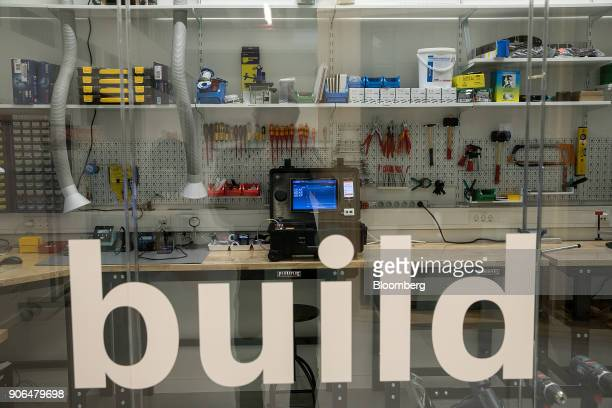 The word 'build' sits on a glass panel as a Bosch Software Innovations Production Performance Manager machine sits on a workbench with a selection of...