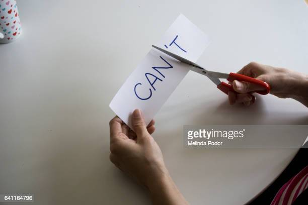 the word can't, with the 't cut off to spell can - attitude stock pictures, royalty-free photos & images