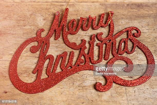 The word Christmas on wooden table