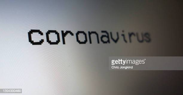 """the word """"coronavirus"""" on a computer monitor - lockdown stock pictures, royalty-free photos & images"""