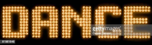 The word dance in illuminated light bulbs