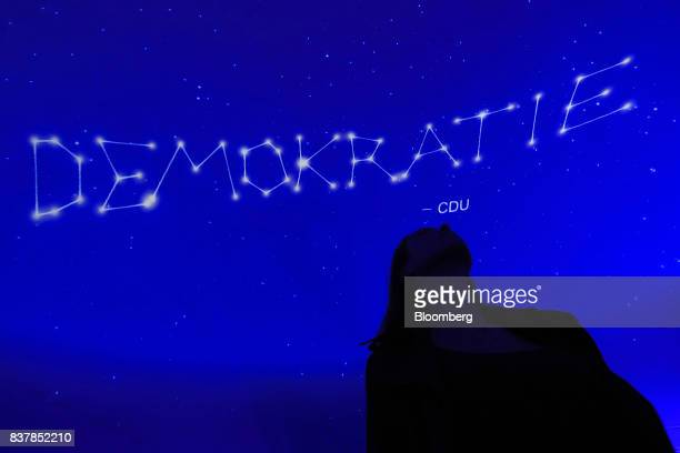The word democracy is spelled out in an astral display inside the Christian Democratic Union walkin manifesto located inside a former department...