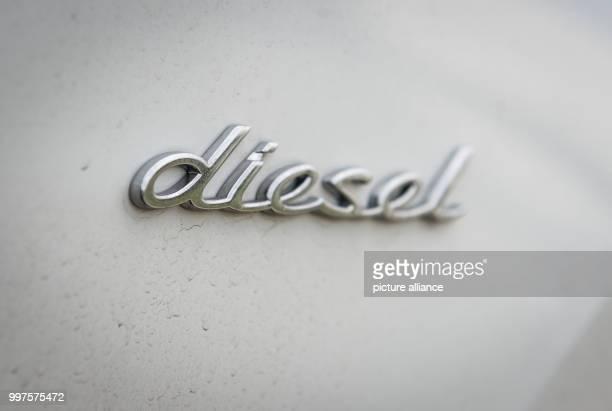 The word 'diesel' can be seen on a Porsche Cayenne 30 Liter Diesel photographed in StuttgartZuffenhausen Germany 28 July 2017 German Minister of...