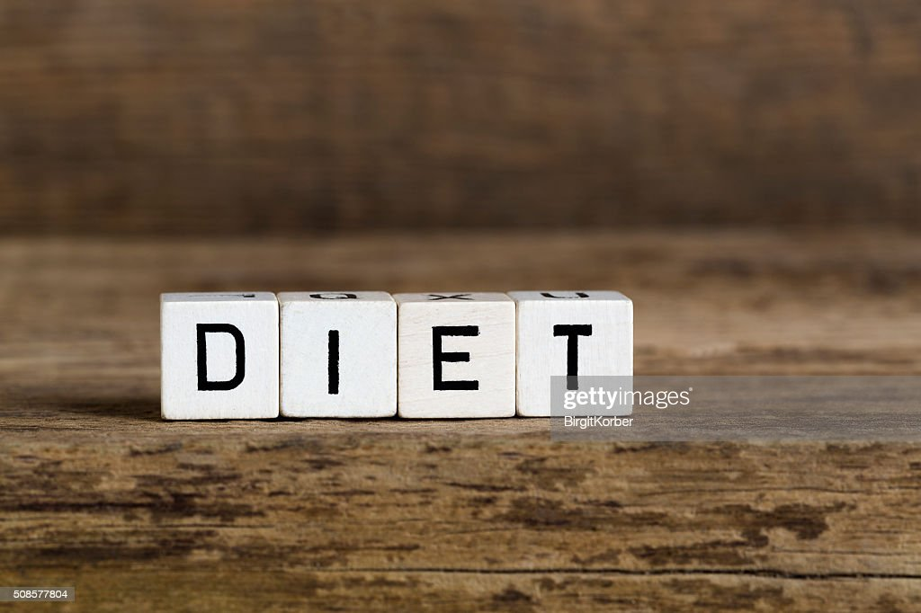 The word diet written in cubes : Bildbanksbilder