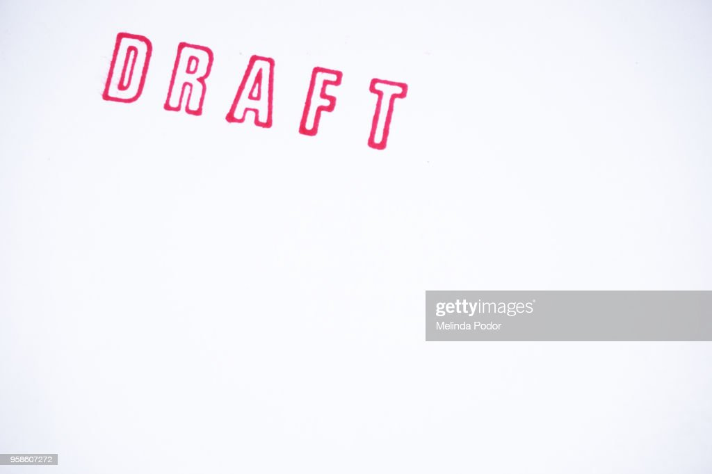 The word DRAFT stamped on paper : Stock Photo