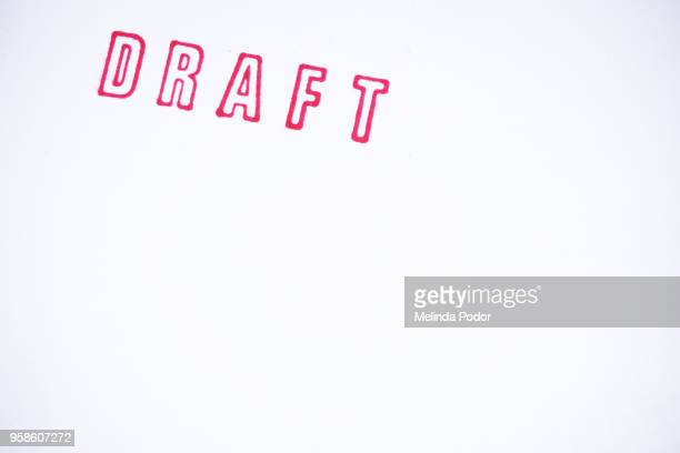 The word DRAFT stamped on paper