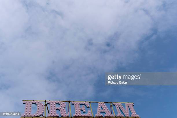 The word 'Dream' is beneath a blue sky and high cloud, at 'Dreamland', the historical funfair in the English seaside town of Margate, on 26th July,...