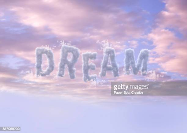 the word dream up in the sky digitally structured in a cloudy looking font - typographies stock photos and pictures