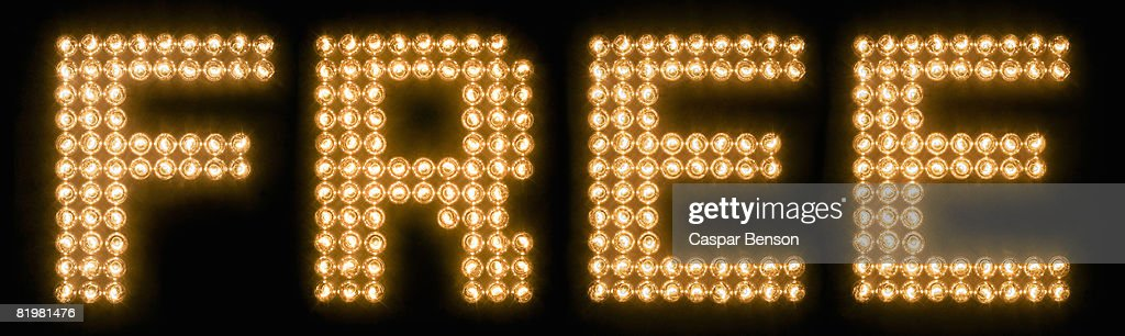 the word free in illuminated light bulbs ストックフォト getty images
