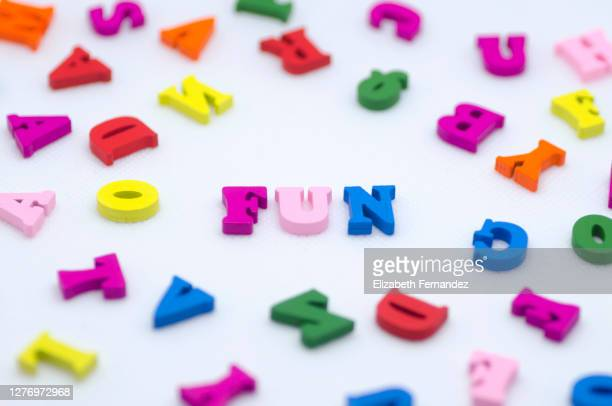 the word -fun- spelled with colorful wooden letters on white background - single word stock pictures, royalty-free photos & images