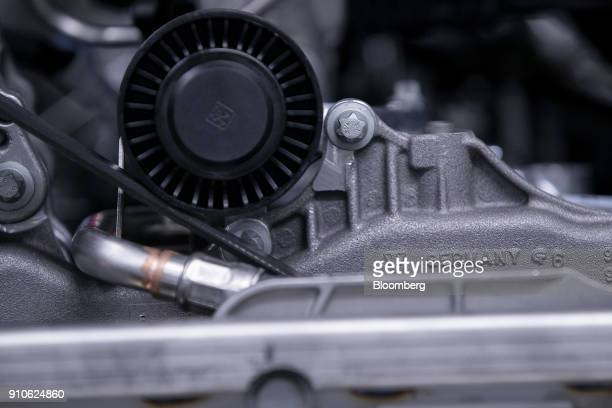 The word 'Germany' sits on a Porsche luxury automobile engine on the production line inside the Porsche AG factory in Stuttgart Germany on Friday Jan...