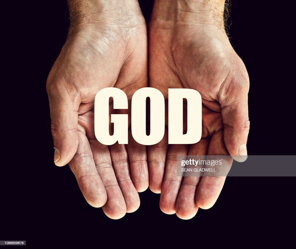 The word god in hands : Stock Photo