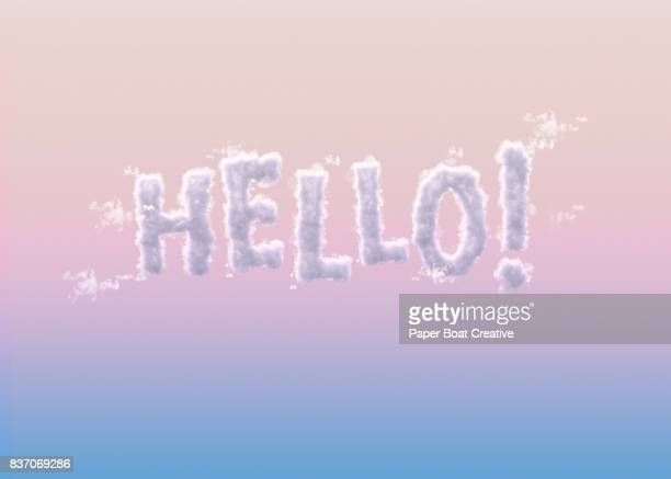 the word hello! formed with clouds to look like a unique typeface up against a gradient colored sky - typographies stock photos and pictures