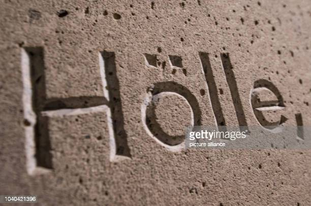 The word 'Hoelle' can be read on the wall from a quote referring to the experiences a war victim at newly opened Holocaust Memorial site in the...