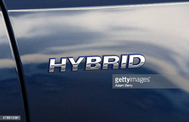 The word hybrid is seen on a hybrid Volkswagen Jetta automobile at the Electric Mobility Week , a public Volkswagen event at the former Tempelhof...