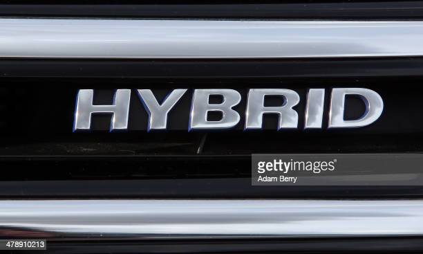The word hybrid is seen on a hybrid Volkswagen Touareg automobile at the Electric Mobility Week , a public Volkswagen event at the former Tempelhof...