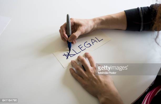 The word illegal, with the letters i and l crossed out to spell legal.