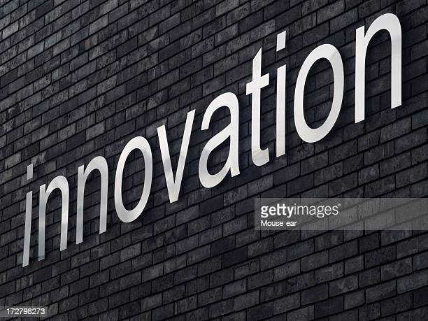 The word innovation on a brick background