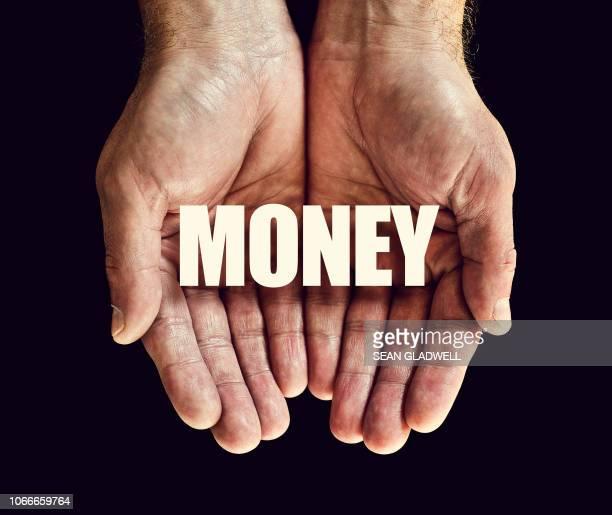 The word money in hands