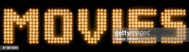 The word movies in illuminated light bulbs