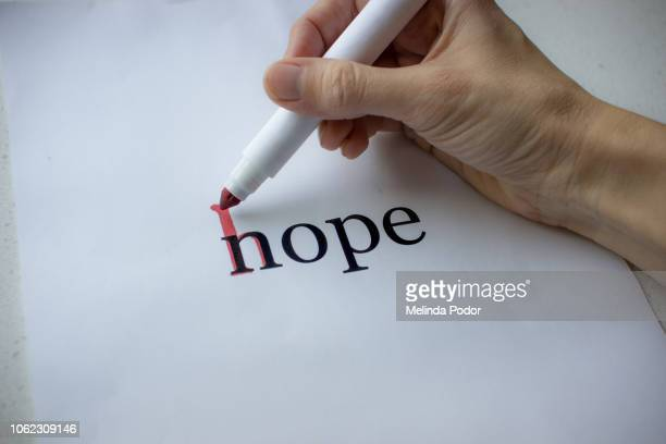 the word nope changed into hope with a red marker - hope stock pictures, royalty-free photos & images