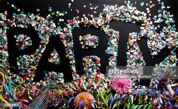 The word PARTY stenciled in confetti