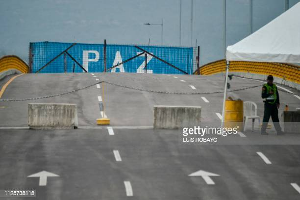 The word Peace is seen written on one of the containers placed by loyalists of Venezuelan President Maduro to prevent access to the country through...