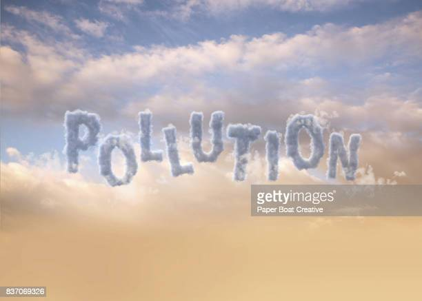 the word pollution formed by dark clouds - typographies stock photos and pictures