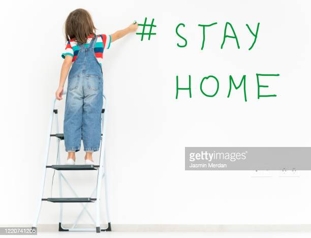the word stay home, save you by coronavirus - writing on wall made by child - single word stock pictures, royalty-free photos & images