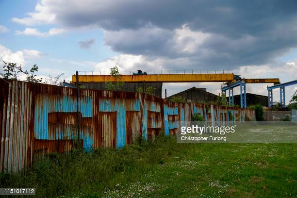 The word steel is painted on a rusting fence as it is announced that Scunthorpe's British Steel's works has been forced into liquidation today on May...