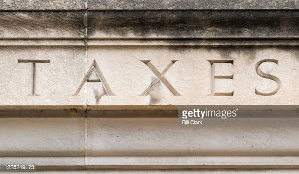 The word TAXES is seen on the facade of the Internal Revenue Service building in Washington on Tuesday, July 7, 2020.