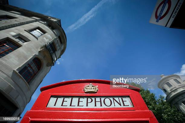 The word 'Telephone' sits above the door of a red fixedline telephone box in London UK on Monday June 3 2013 BT Group Plc the UK's largest fixedline...