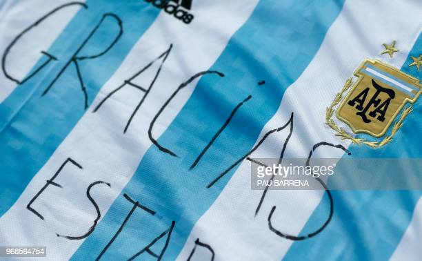 The word 'Thanks' is written on a jersey of Argentina's national football team during a proPalestine gathering to celebrate the cancellation of a...
