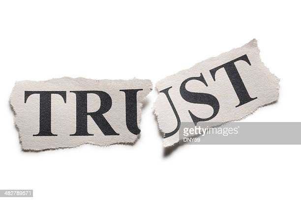 The word trust printed on paper torn in half