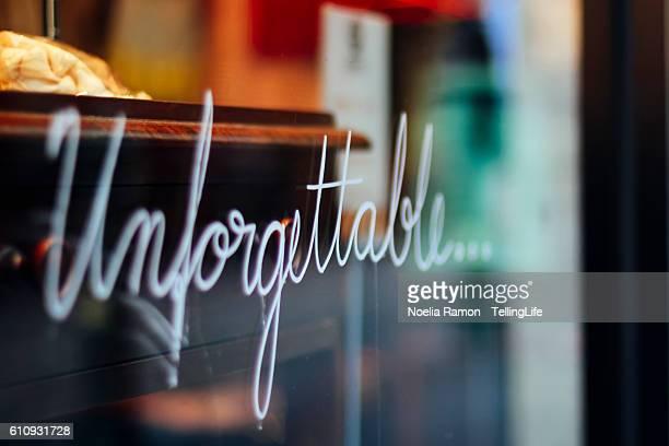 The word: 'Unforgettable' written in a window