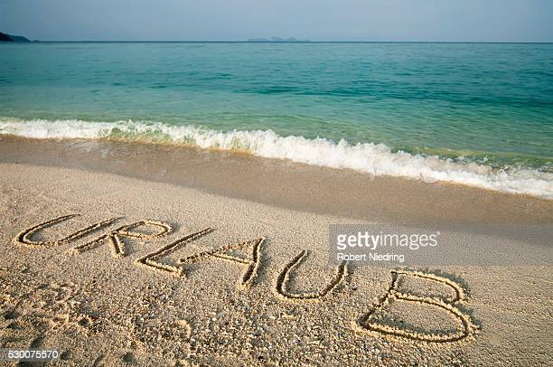 The word 'Urlaub' scratched into sand at beach, Koh Lipe, Thailand
