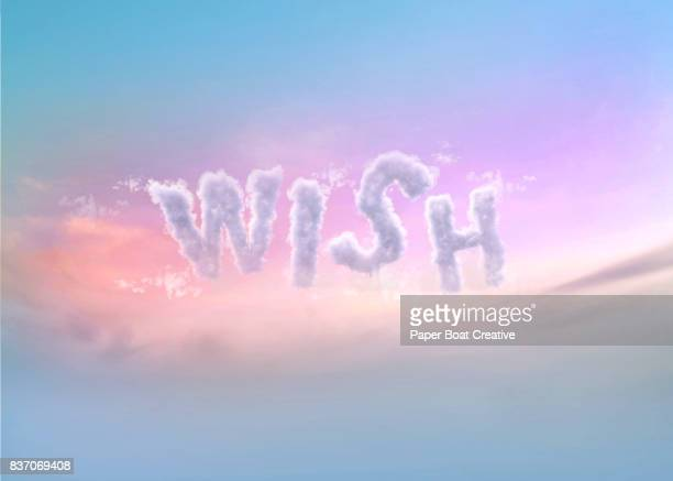 the word wish configured out of clouds, finished with a pinkinsh sky background - typographies stock photos and pictures