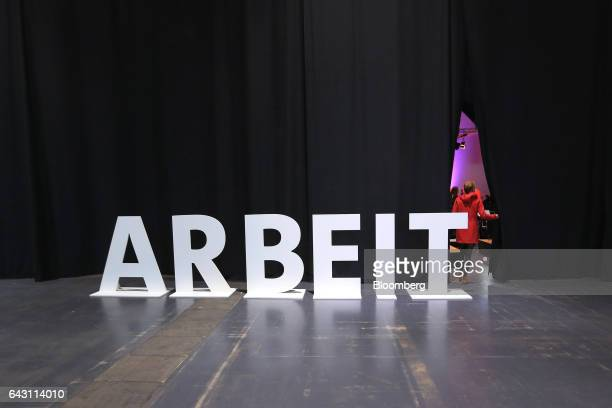 The word work stands beside curtains as an attendee enters the Social Democrat Party labour conference in Bielefeld Germany on Monday Feb 20 2017...