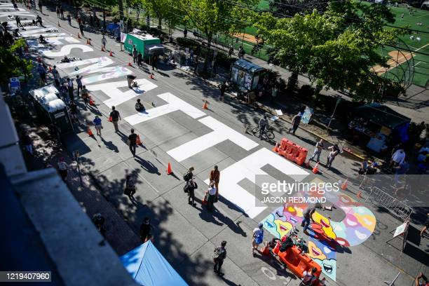 TOPSHOT The words Black Lives Matter are painted in the middle of East Pine Street in the newly created Capitol Hill Autonomous Zone in Seattle...