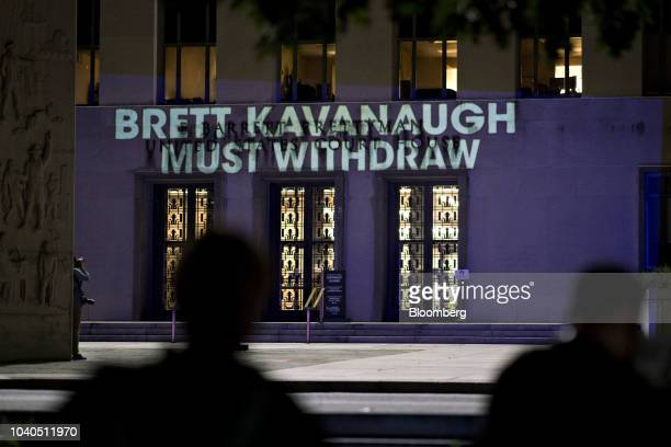 The words 'Brett Kavanaugh Lied Every Time He Testified' are projected by demonstrators onto the E Barrett Prettyman United States Courthouse in...