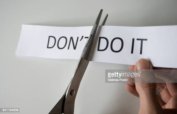 The words 'Don't do it', part of it cut off to spell 'do it'