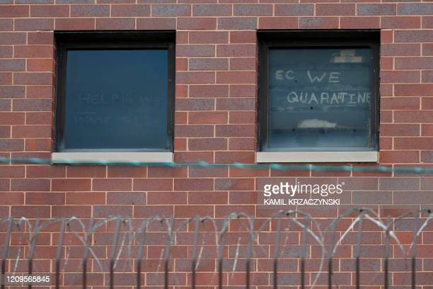 The words ec we quarantine are seen written in a window at the Cook County Department of Corrections housing one of the nation's largest jails in...