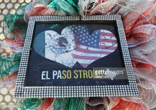 The words 'El Paso Strong' are written on a memento at a temporary memorial in Ponder Park honoring victims of the Walmart shooting which left 23...