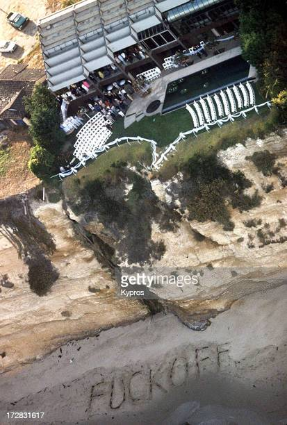 The words 'Fuck Off' are written in the sand outside the Malibu house where singer Madonna and actor Sean Penn are getting married 16th August 1985...