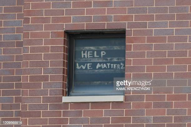 The words help we matter 2 are seen written in a window at the Cook County Department of Corrections housing one of the nation's largest jails is...
