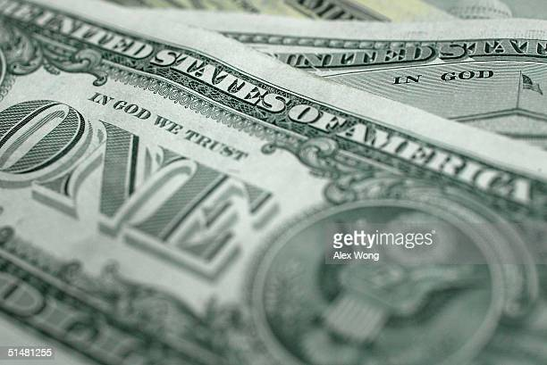 The words In God We Trust are seen on US currency October 14 2004 in Washington DC Although the US constitution prohibits an official state religion...