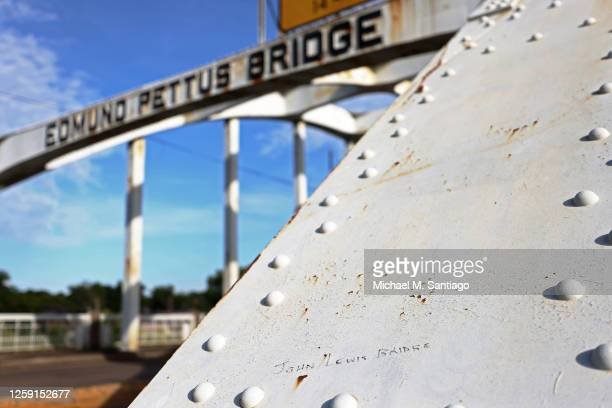 "The words ""John Lewis Bridge"" are written in marker on the Edmund Pettus Bridge on July 26, 2020 in Selma, Alabama. On the second of six days of..."