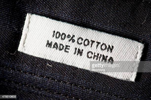 The words 'Made in China' are displayed on a shirt label in an arranged photograph in Hong Kong China on Wednesday March 5 2014 An official Chinese...